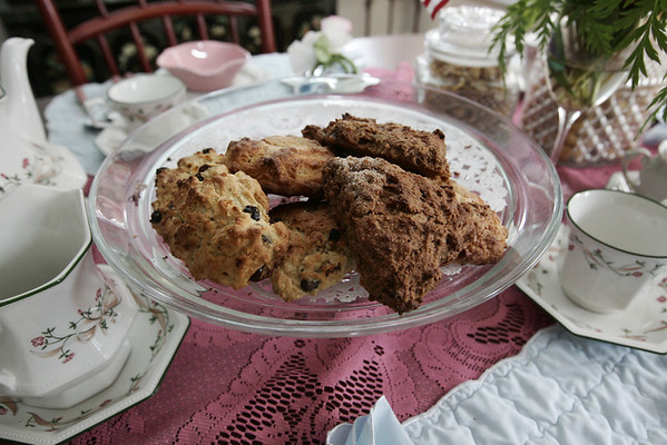 Nancy Ferguson, a native of England, serves speciality scones to her guests at the Pink House, a bed and breakfast in Marblehead run by her and her husband.