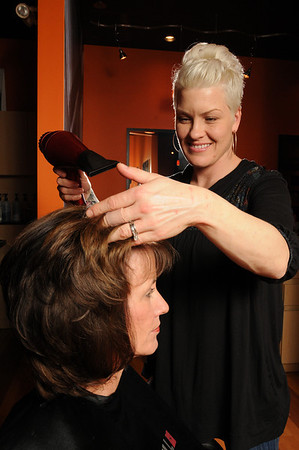 Marblehead:<br /> Kim Cutting blow dries customer Karen Lang's hair at Bliss Salon and Spa.<br /> Photo by Ken Yuszkus/Salem News, Wednesday, January 13, 2010