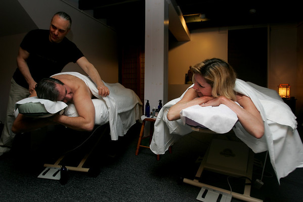 Gabrielle Yetter of Marblehead and her husband Skip, receive a couples massage from Blane Allen and Monique Illona of Hand in Hand Massage. Photo by Deborah Parker/January 26 ,2009