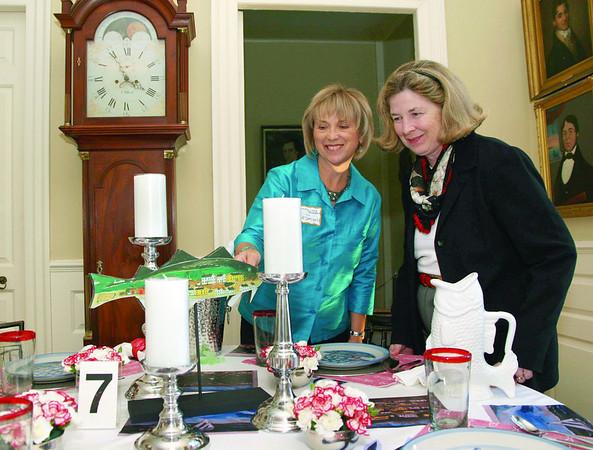 "City Desk, Marblehead:Ê At left, designer Ginny von Rueden, shows her Tablescape ""J.O.J. Frost and Fishing"" to Pam Peterson, museum director, both are from Marblehead.Ê von Rueden is the proprietor of VvR Designs, Marblehead at the benefit for the Marblehead Museum and Historical Society, Thursday, at the Jeremiah Lee Mansion on Washington Street. Photo by Frank J. Leone, Jr."