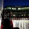 Boston: A Marblehead player takes a quiet moment to enjoy his surreal surroundings - on the ice in the center of Fenway Park.  Photo by Liz Curtis
