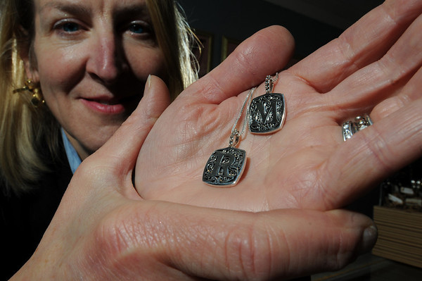 Marblehead:<br /> Tory Kelley, of Tory's Jewelry, holds pendants that have initials.<br /> Photo by Ken Yuszkus/Salem News, Friday, January 15, 2010