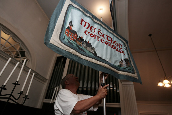 Phil Murphy of Marblehead helps to set up before the start of the last Me and Thee Coffeehouse of the season held at the Unitarian Universalist Church in Marblehead. Photo by Deborah Parker/August 5, 2009