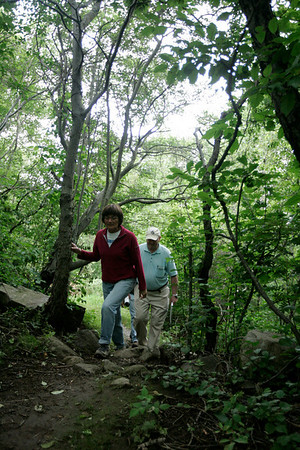The newest addition to Marblehead's conservation lands, the Robinson Farm, was purchased by the Town in 2005. For almost 200 years this 3.5 acre site was a working dairy farm and now is open to the public for passive enjoyment. Here Joan McDuff and Don Morgan walk through the property.
