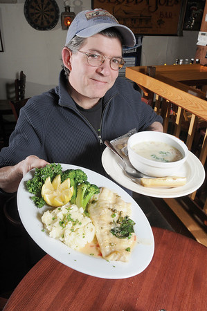 Marblehead:<br /> Phil Sweeney, Jr., of Sweeney's Retreat, presents two of their dishes, sole piccata and fish chowder. <br /> Photo by Ken Yuszkus/Salem News, Wednesday,  February 4, 2009.