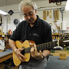 Marblehead:<br /> Bill Tippin plays his completed staccio guitar that he makes in his shop.<br /> Photo by Ken Yuszkus/Salem News, Friday, July 10, 2009.