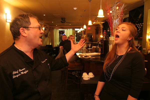 "Marblehead: Sergio Maffeo and his daughter, Ali, sing one of their favorite duets, ""The Prayer,"" by Celine Dion and Andrea Bocelli, for their guests at Trattoria Sablone in Marblehead. Photo by Matthew Viglianti/Staff Photographer Wednesday, January 27, 2010."