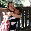The Serra's two childre, Julie and Eric, both 7, playfully hug while at their home on Orne Street. Photo by Deborah Parker/August 21, 2009