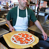 Marblehead:<br /> Tony Brogna, the owner of Tony's Pizza, makes pizza at his business.<br /> Photo by Ken Yuszkus/Salem News, Monday, April 27, 2009.