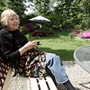 Nancy Ferguson, a native of England, sits in the backyard of the Pink House, a bed and breakfast in Marblehead run by her and her husband, Jim.
