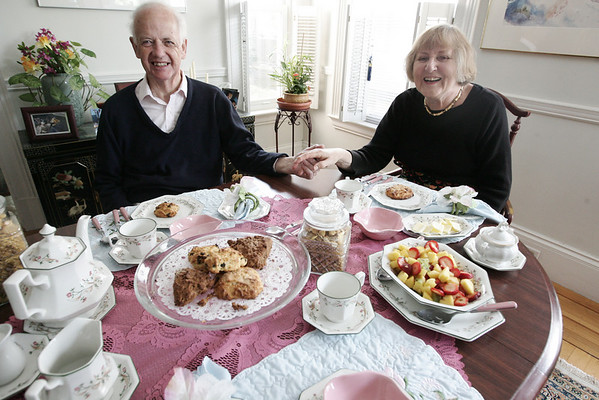 Nancy Ferguson, a native of England, and her husband, Jim sit in the pink dining room at the Pink House,a bed and breakfast in Marblehead run by her and her husband. Nancy bakes up specialty scones for her guests to enjoy.