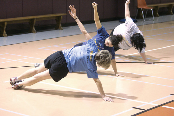 Marblehead:  Kay O'Dwyer, Joelle Lydon, and Sheryl White Vincent,during their Boot Camp workout, at the Marblehead Community Center. The Boot Camp classes are lead by Betsy Caliri. Photo by Mark Lorenz/Salem News