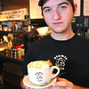 Marblehead:<br /> Jeff Gately, barrista at the Atomic Cafe, made the hot caramel cider.<br /> Photo by Ken Yuszkus/Salem News. Thursday, October 16, 2008.