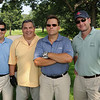 Salem:<br /> From left, Mike Trigilio, Bob Trigilio, Andy Innocenti, and Steve Ziolkowski, all from Coastal Care, stand at the 18th hole at the the Fourth Annual Rey Moulton Memorial Golf Tournament, sponsored by the Marblehead Chamber of Commerce at Kernwood Country Club.<br /> Photo by Ken Yuszkus/Salem News, Monday, August 3, 2009.