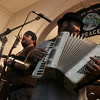 Ethan Scott Baird, left, and ___ of the band Pesky J. Nixon peform a sound check before the start of the last Me and Thee Coffeehouse of the season held at the Unitarian Universalist Church in Marblehead. Photo by Deborah Parker/August 5, 2009