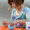 Marblehead:<br /> Joelle Nicosia paints her pumpkin/gourd? in the Nicosia backyard.<br /> Photo by Ken Yuszkus/Salem News, Thursday October 8, 2009.