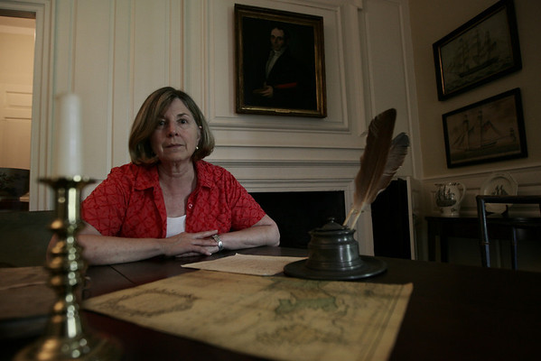 A psychic in the 1970's claimed to have had a vision of someone burning Jeremiah Lee's papers in a fire place in the mansion. Here Pam Peterson sits in Lee's office. Photo by Deborah Parker/August 20, 2009.