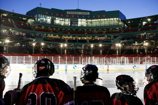 Boston: Players from the Marblehead hockey team wait for their chance to get on the ice at Fenway Park in this once in a lifetime opportunity to play hockey on hallowed baseball ground.  Photo by Liz Curtis