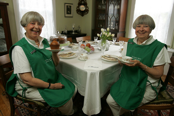 Sisters Suzanne and Linda Thomas run a Bed & Breakfast at 17 Chestnut Street in Marblehead. Here they pose in the dining room.