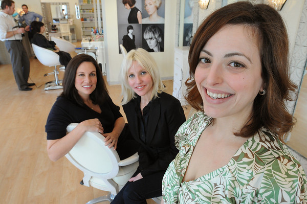 Marblehead:<br /> From left,  Kathy Glabecki, owner of Chakra personal training boutique, her sister Kerry Callahan, La Belle Femme's owner, and Sara Pouladian, a bride who went through the businesses' combined Bridal Boot Camp. They are at La Belle Femme.<br /> Photo by Ken Yuszkus/Salem News, Friday, February 5, 2010.