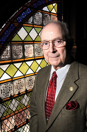 Marblehead:<br /> Retired Judge Joseph Dever stands near the stained glass window in Abbot Hall.<br /> Photo by Ken Yuszkus/Salem News, Friday,  January 9, 2009.