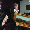 Marblehead:<br /> Jane Weiss, left, watches as Deborah Greel, executive director, carries  a painting by William Hasseltine titled Marblehead Rocks. They were searching a closet at the Marblehead Arts Association for hidden forgotten art treasures.<br /> Photo by Ken Yuszkus/Salem News, October 8, 2008.