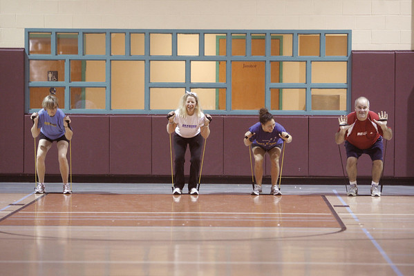 Marblehead: From left, Kay O'Dwyer, Nancy Norman Horrigan, Joelle Lydon, and Ron Caliri take part in a morning Boot Camp workout, at the Marblehead Community Center. The Boot Camp classes are lead by Betsy Caliri. Photo by Mark Lorenz/Salem News