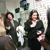 Elisabeth Steinfeld from Marblehead, center left, and Ann Marie Casey, executive director for the Marblehead Chamber of Commerce, right, talk with Katherine Koch, assitant to the executive director of the Chamber of Commerce, left, and Rhiannon Thackeray of Swampscott, right, during a wine and cheese reception at DS Designs in Marblehead after a day of fundraising for the Room to Grow organization on Thursday, October 23, 2008. Room to Grow provides parents raising babies in poverty with one-one-one parenting support during the child's first three years.