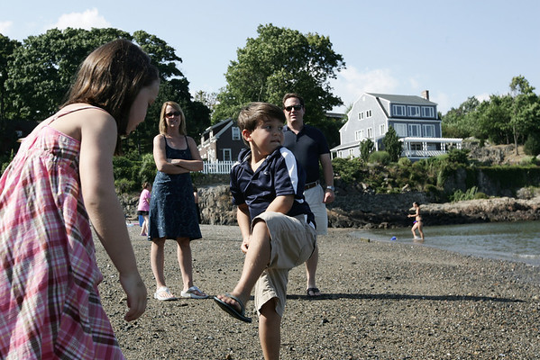 MaryAnn and Ray Serra look on as their two children, Julia and Eric, 7, throw rocks into the water while playing at Gashouse Beach near their Barnegat neighborhood home. Photo by Deborah Parker/August 21, 2009