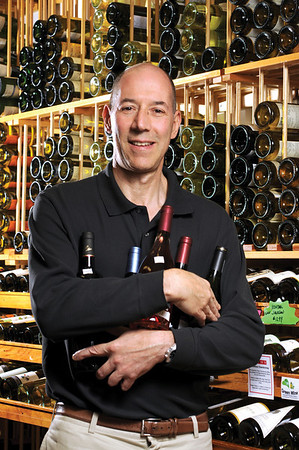 Marblehead:<br /> George Shube, a wine expert, and two wines he plans to pair with food at Shubie's market.<br /> Photo by Ken Yuszkus/Salem News, Wednesday October 28, 2009.