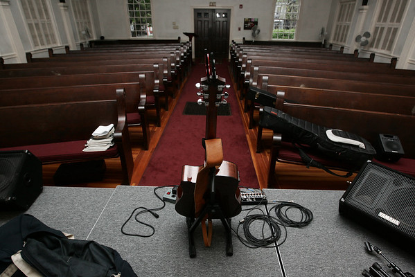 A lone guitar sits on stage before the start of the last Me and Thee Coffeehouse of the season held at the Unitarian Universalist Church in Marblehead. Photo by Deborah Parker/August 5, 2009