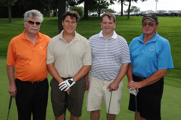 Salem:<br /> From left, Peter Brown, Jim Nye, Mark Dewling, and Hugh Bishop, all from National Grand Bank, at the 18th hole at the the Fourth Annual Rey Moulton Memorial Golf Tournament, sponsored by the Marblehead Chamber of Commerce at Kernwood Country Club.<br /> Photo by Ken Yuszkus/Salem News, Monday, August 3, 2009.