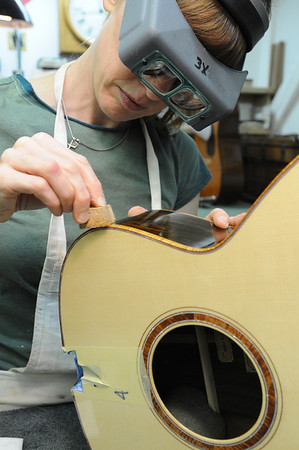 Marblehead:<br /> Alicia Cohen is sanding the finish of one of the guitars in Bill Tippin guitar shop.<br /> Photo by Ken Yuszkus/Salem News, Friday, July 10, 2009.