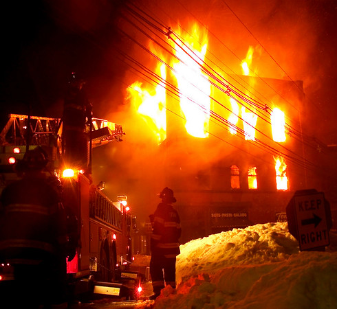Marblehead: Firefighters are silhouetted from the flames ragging from Tony's Pizza in Marblehead at the height of the 4 alarm fire early this morning.  (Photo by Jim Daly/Salem News). Thursday, February 20, 2003 (NOTE: THIS IS A DIGITAL CAMERA IMAGE).<br /> **************************************<br /> Filter: Min (QMPro: Red Radius:0/Blue Radius:6/Desp.)<br /> USM: Normal (Amt:200/Radius:0.3/Thresh:2)<br /> File Size: 7.5MB<br /> Original file name: 9B233967.TIF