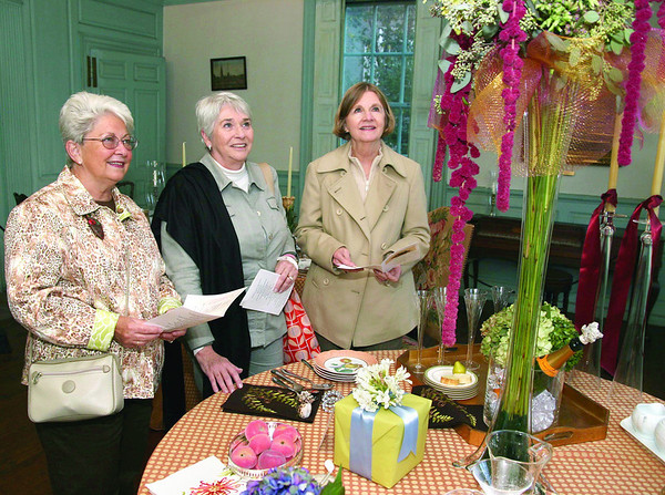 "City Desk, Marblehead:Ê From left, Leanne Dyson, Judi Tarlow and Joan Ingalls, all of Marblehead, are inspired by ""Reflecting Gardens of the Lee Mansion"", TablescapeÊbyÊdesigner Linda Newall of Surroundings, Marblehead.Ê The tall flowers were done by Paulette Brophy of Flower House, at the benefit for the Marblehead Museum and Historical Society, Thursday, at the Jeremiah Lee Mansion on Washington Street. Photo by Frank J. Leone, Jr."