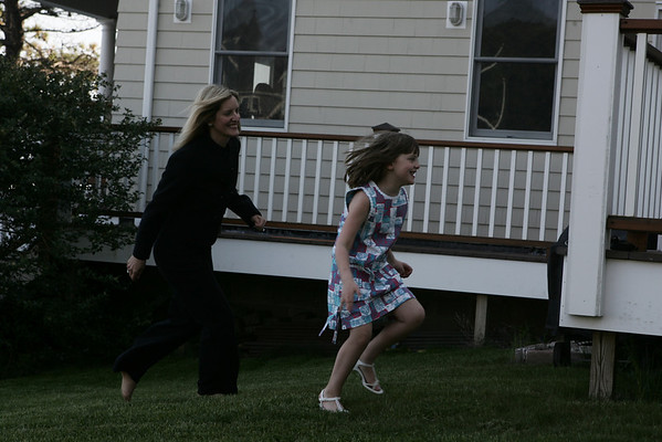 Heather Finn and her daughter, Farrah, 5 run around their back yard of their home, Heather's husband's childhood home which they bought and renovated in Clifton Heights. Clifton Heights is a combination of five private roads overseen by the Clifton Heights Improvement Society. This is a very tight-knit neighborhood that puts on organized activities all year. In the last 15 years or so, at leat 12 former residents have moved back to the neighborhood to bring up their children. Photo by Deborah Parker