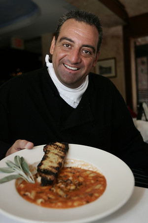 Chef Frank Pellino, owner of Pellino Restaurant in Marblehead, displays his specialty fall soup Pasta Fagioli. Photo by Deborah Parker/July 28, 2009