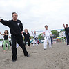 Marblehead:<br /> Bob Humenn leads the group of people in Tai Chi on Devereux Beach.<br /> Photo by Ken Yuszkus/Salem News, Saturday May 9, 2009.
