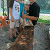 Andy Nyberg with his kids, Adam, 5, Maya,8, and Serena, 2, at Seaside Nursery School. The bench was made by his father, Eric and the school was co founded by his mother, Pat.
