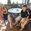 MaryAnn and Ray Serra and their two children Julia and Eric, both 7, live in the Barnegat neighborhood of Marblehead. There MaryAnn and Ray relax as Julia and Eric play on their back deck. Photo by Deborah Parker/August 21, 2009