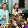 Marblehead: Lighting the candles in the family parlor of the Lee Mansion are, from left, Kim Downing and Pam Peterson, both of Marblehead, Peterson is the museum director, at Shubie's Harvest Wine & Food Festival to benefit the Friends of Marblehead Public Schools and the Marblehead Museum and Historical Society, Friday, at the Jeremiah Lee Mansion, Marblehead. Photo by Frank J. Leone, Jr.