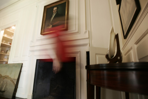 A psychic in the 1970's claimed to have had a vision of someone burning Jeremiah Lee's papers in a fire place in the mansion. Here Pam Peterson walks past the fireplace in Lee's office. Photo by Deborah Parker/August 20, 2009.