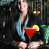 "Marblehead:<br /> Maria Catalano, bartender at the Caffe Italia, mixes up her ""Mariatini"" at the restaurant.<br /> Photo by Ken Yuszkus/Salem News, Tuesday, October 14, 2008."