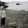 Bette Hunt, local historian, stands at Lovis Cove, also known as Screeching Woman's Beach in Marblehead. Photo by Deborah Parker/August 13, 2009