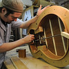Marblehead:<br /> Kevin Chubbuck is marking the guitar bottom for notchig. He works for Bill Tippin. Bill Tippin makes guitars in his shop.<br /> Photo by Ken Yuszkus/Salem News, Friday, July 10, 2009.