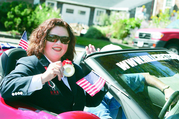 Marblehead: Para olympic sailing gold medal winner, Maureen McKinnon-Tucker waves to the crowd in front of the Barnacle Saturday as part of a parade in her honor. Starting at the Old Town House, Tucker was driven in a red corvette through the streets of downtown ending with a ceremony at Fort Sewall.<br /> Photo by Deborah Parker/Salem News Saturday, September 20, 2008
