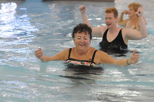 Marblehead:<br /> Front to back, Addie Hennigar, Erin Cheever, and Linda Elsaesser exercise during the water aerobics class instructed by Cheryl Verrette at the Marblehead YMCA on Thursday morning.<br /> Photo by Ken Yuszkus/Salem News, Thursday,  October 28, 2010.