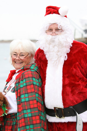 Marblehead: Santa and Mrs. Claus arrive at State Street in Marblehead from a lobster boat hailing from the North Pole as throngs of children gather to greet them.  Photo by Liz Curtis
