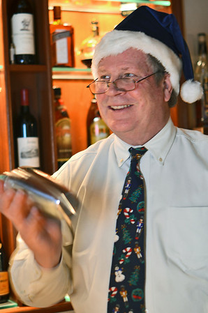 Harborlight Inn's contribution to winter drinks is the White Christmas Chocolate Raspberry Martini with Bartender Ron Amon.  photo by Mark Teiwes / Salem News