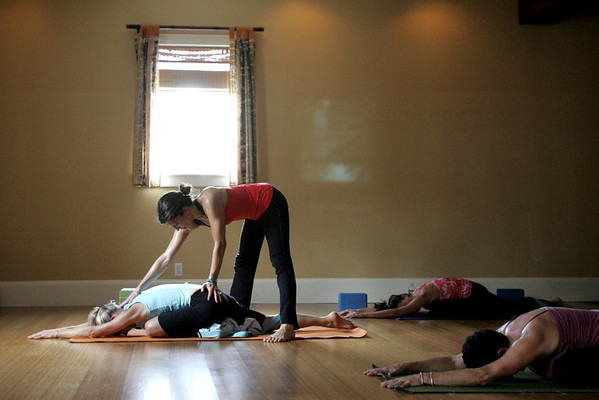 Yoga instructor Willa Worsford helps student Lolli Leeson of Marblehead work through a pose during a PranaVayu yoga class held at the Yoga Loft in Marblehead. Photo by deborah parker/october 26, 2010